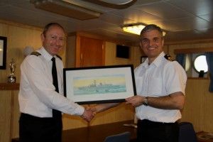 "Lt Cdr 'Des' Hirons, presenting ""HMS SOMERSET"" to Cdr Paul Bristowe RN."