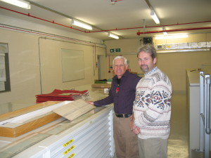 Examining the water colours made at sea by order of King George III by the official marine artist Serres, Gordon Frickers with Guy Hannaford, in the UKHO.
